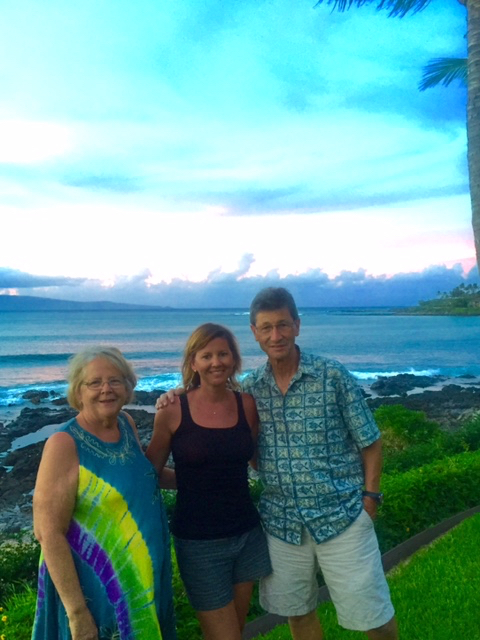Ingrid and her parents Phil and Jane catching a sunset
